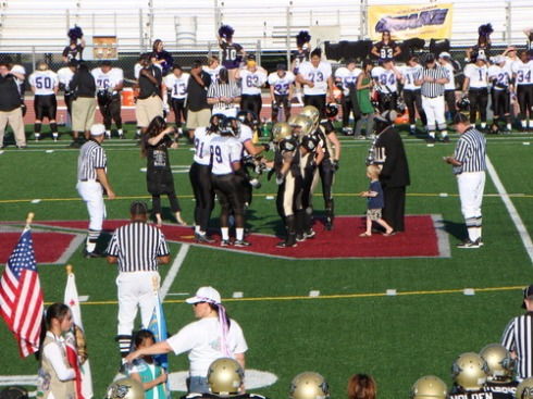 Captains take the field for coin toss